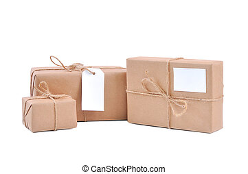 Three brown packages with blank labels on white