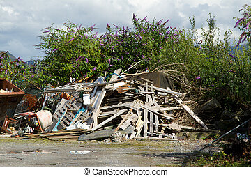 Construction rubbish - A yard, wasteground, with a pile of...