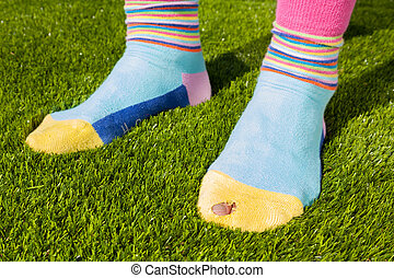 Two feet with colorful socks