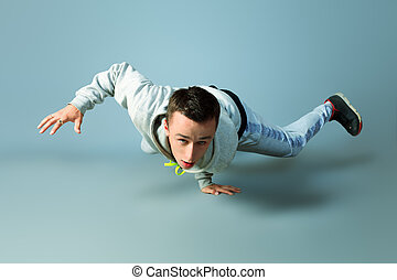 breakdance - Trendy young man dancing hip-hop at studio.