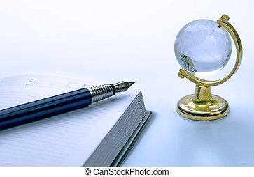 notebook and pen, globe