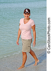 Attractive Woman Wearing Pink Ribbon on Hat