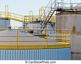 Group of large steel storage tanks at refinery - Group of...