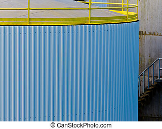 Large steel storage tank at refinery terminal