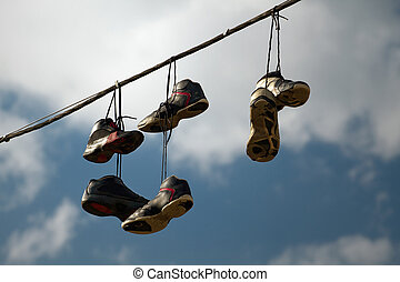 Sneakers Hanging on a Telephone Line - Sneakers hanging on a...