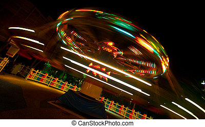 Slow shutter work of a playground ride at  night time