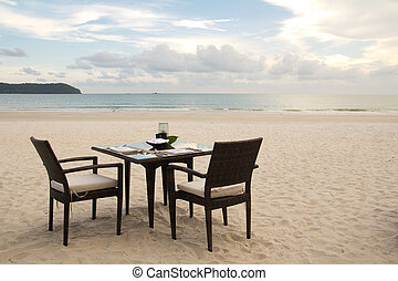 Dining table on beach - Dining table prepared for two on...