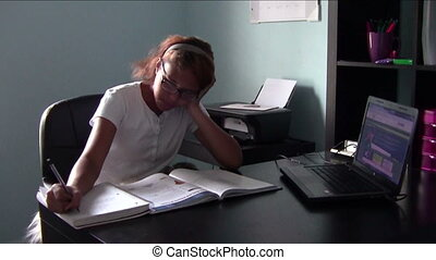 Homeschool Student - Homeschool student doing schoolwork at...
