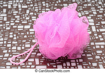 Hot pink loofah for a bath and body product