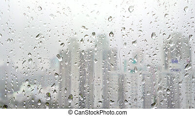 rain drops on glass with city background