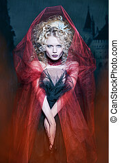 glamorous blonde girl in a maroon cape with stunned hairdo....