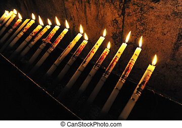 Candles at the Church of the Holy Sepulcher in the Jerusalem old city.