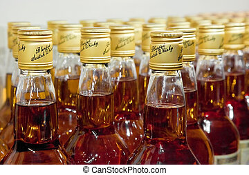 bottles of scotch blended whisky - closeup of bottles of...