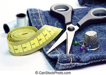 Jeans with sewing utenstils - Denim jeans with dressmaking...