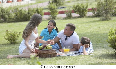 Picnic together - Parents having a picnic together with...