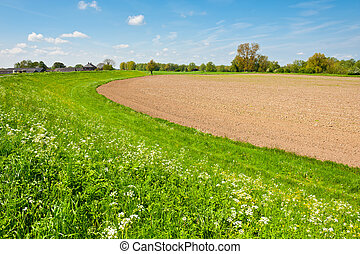 Plowed Field - Protective Dam and Plowed Field in the...