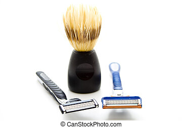 Shaver with paintbrush on white background
