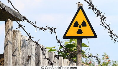 Radioactivity Sign and barbed wire