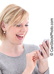 Laughing woman reading text message