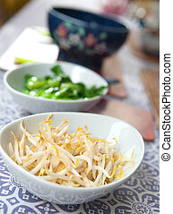 Bowls of steamed oriental vegetables, bean sprouts and baby...