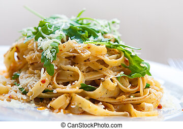 Delicious fettucine pasta with sundried tomato and rocket...