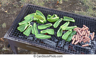 barbecue party - barbecue cooking image with sausages and...