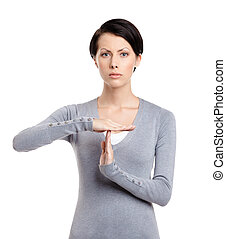 Time out hand gesture - Serious girl gestures timeout,...