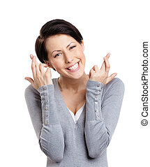 Young woman shows crossed fingers, isolated on white