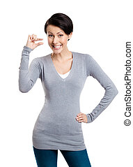 Attractive woman gestures small amount