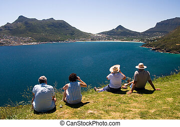 Watching the Cape Town - Four tourists are watching the...