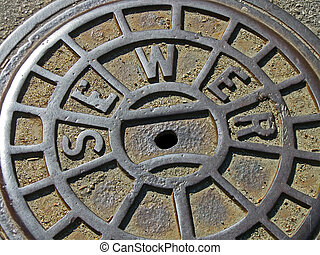 metal sewer manhole, industry details - focus on center...