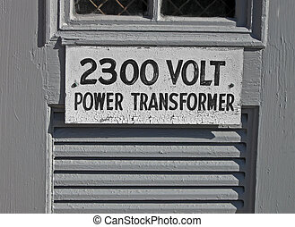 power transformator 2300 volt as text on vintage wooden...
