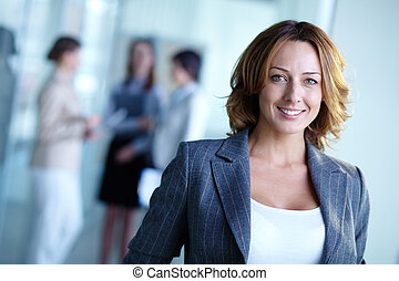 Employer - Image of pretty businesswoman looking at camera