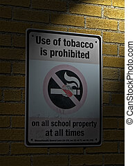 use of tabacco prohibited in all schools as message on sigbboard on brick wall with power lighting, health details