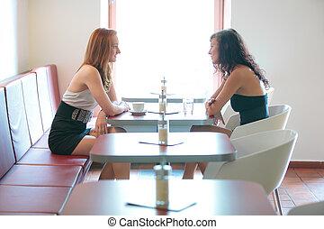 Two women in a restaurant, overhead version - Two women...