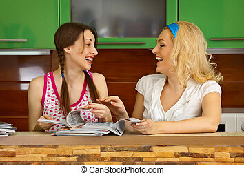 Two girlfriends with magazines - Two girlfriends in the...