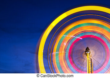 Ferris wheel with motion blurred lights with copy space
