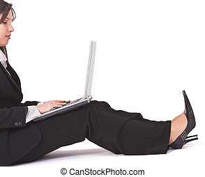 Woman wotking on laptop - Businesswoman working on a laptop...