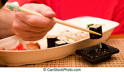 Food Sushi and mans hand