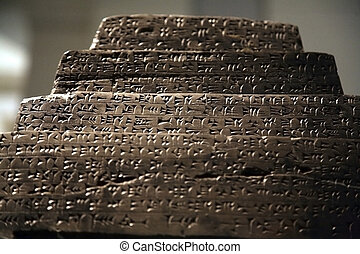 assyrian writing - ancient assyrian writing on a stone