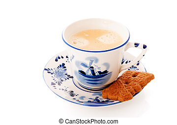 Dutch cup of coffee with cookie
