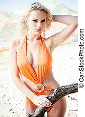 Bikini - Young woman in bikini posing on a beach