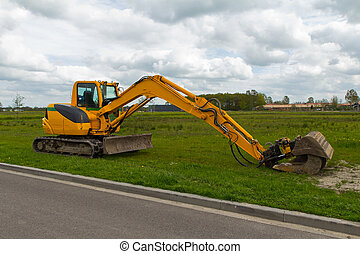 mini excavator - yellow mini excavator with a beautiful blue...