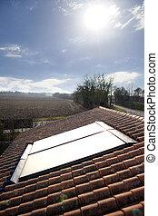 Sun shining onto solar panel
