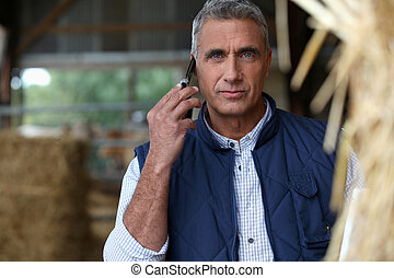 Farmer on the phone