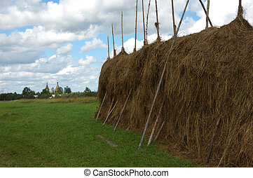 Haystack on the meadow in North Russia