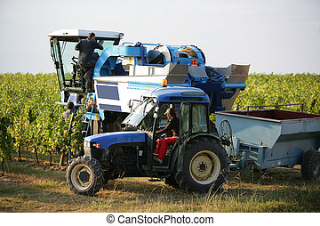 Farm vehicles in a field