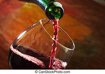 Red wine being poured into wine glass