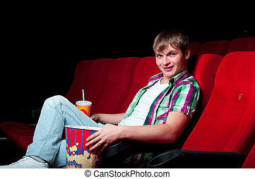 man in cinema - portrait of a man in a movie theater