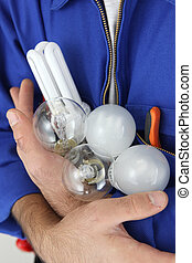 Electrician holding lightbulbs